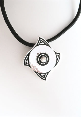 Minimalist, curved diamond shape pendant with a pearl center and fine black enamel work