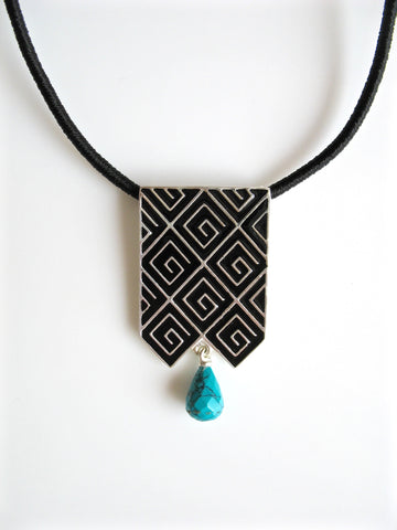 Stunning, long rectangular pendant with fine black enamel work and a turquoise drop