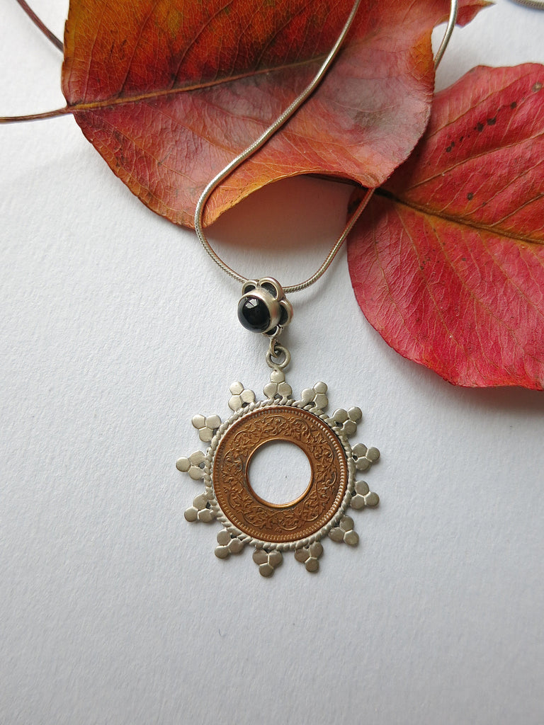 Hauntingly beautiful coin pendant with an onyx flower (PB-1514)  Necklace, Pendant Sterling silver handcrafted jewellery. 925 pure silver jewellery. Earrings, nose pins, rings, necklaces, cufflinks, pendants, jhumkas, gold plated, bidri, gemstone jewellery. Handmade in India, fair trade, artisan jewellery.