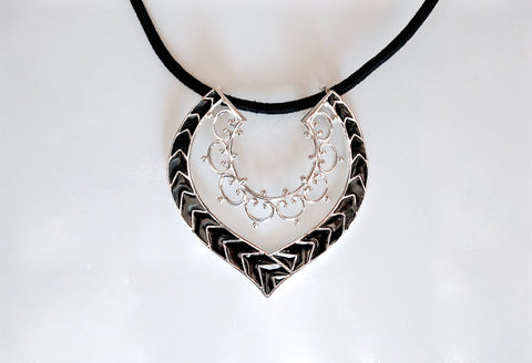 Graceful, positive-negative space, fine black enamel work pendant