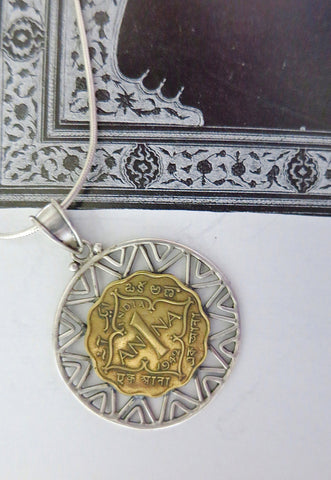Vintage coin pendant with a chic wire-work frame