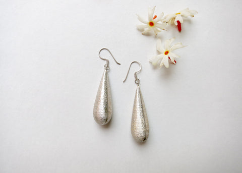 Dramatic, textured long drop earrings (PBE-1005-ER)  Earrings Sterling silver handcrafted jewellery. 925 pure silver jewellery. Earrings, nose pins, rings, necklaces, cufflinks, pendants, jhumkas, gold plated, bidri, gemstone jewellery. Handmade in India, fair trade, artisan jewellery.