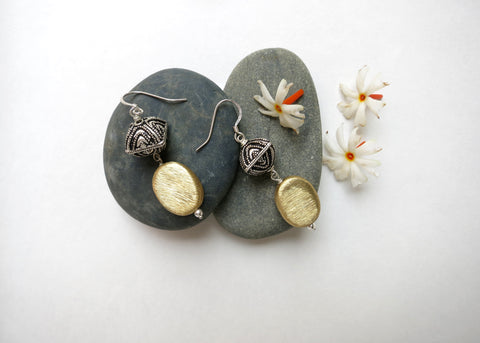 Stunning, dual-tone dangle earrings with contrasting Bali and brush finish beads