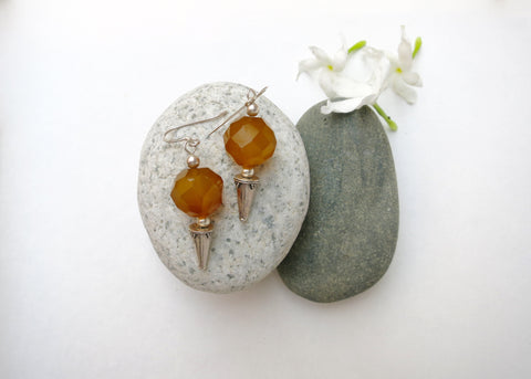 Exquisite, granulation-work earrings with faceted yellow agate bead