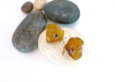 Unique, tumble polished honey agate ear studs, accented with faceted semi precious stone in the center