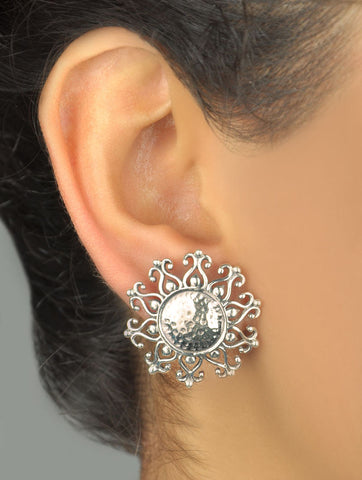 Timeless, Kutch-inspired, round sunburst hammer finish ear studs  Earrings Sterling silver handcrafted jewellery. 925 pure silver jewellery. Earrings, nose pins, rings, necklaces, cufflinks, pendants, jhumkas, gold plated, bidri, gemstone jewellery. Handmade in India, fair trade, artisan jewellery.