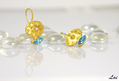 Ethereal, gold-plated oval earrings with navette shape blue topaz