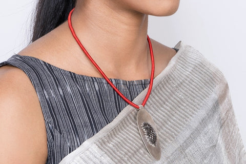Stunning, super chic, long pendant with black rhodium plated paisley motif  Necklace, Pendant Sterling silver handcrafted jewellery. 925 pure silver jewellery. Earrings, nose pins, rings, necklaces, cufflinks, pendants, jhumkas, gold plated, bidri, gemstone jewellery. Handmade in India, fair trade, artisan jewellery.