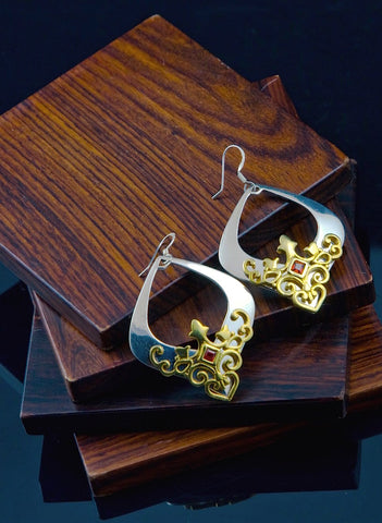 Gorgeous, kite-shape earrings with garnet and gold plated detailing