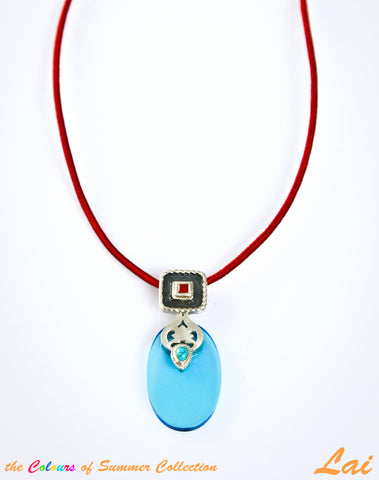 Chic oval blue glass pendant with silver, turquoise & carnelian detailing (PBS-4008)  Necklace, Pendant Sterling silver handcrafted jewellery. 925 pure silver jewellery. Earrings, nose pins, rings, necklaces, cufflinks, pendants, jhumkas, gold plated, bidri, gemstone jewellery. Handmade in India, fair trade, artisan jewellery.