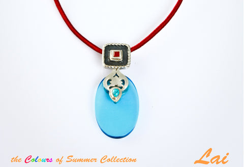 Chic, oval blue glass pendant with silver, turquoise and carnelian detailing
