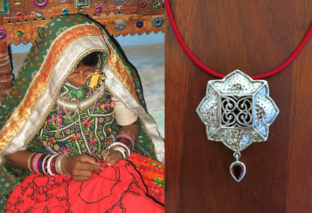 Gorgeous Kutchi 8 petal floral hammer finish pendant with jali work & a garnet drop (PB-7107-P)  Necklace, Pendant Sterling silver handcrafted jewellery. 925 pure silver jewellery. Earrings, nose pins, rings, necklaces, cufflinks, pendants, jhumkas, gold plated, bidri, gemstone jewellery. Handmade in India, fair trade, artisan jewellery.