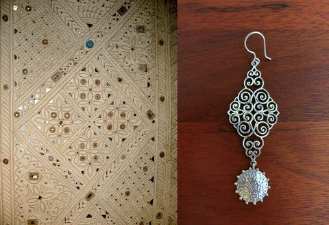 Stunning, wire scroll-pattern earrings with a dangling hammered disc