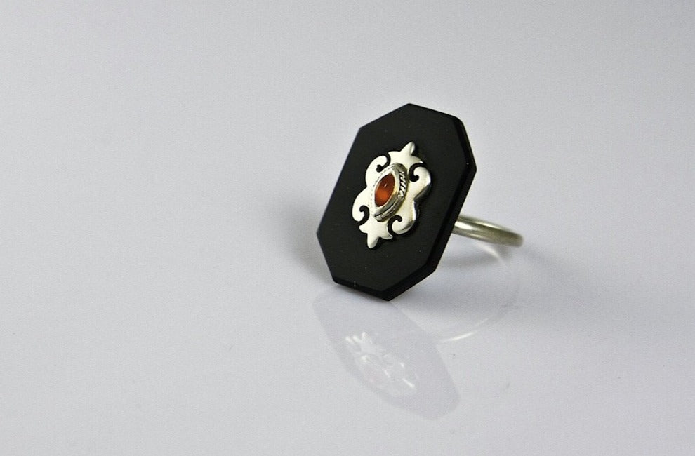 Chic, elegant, rectangular black glass ring with silver and carnelian accent  Ring Sterling silver handcrafted jewellery. 925 pure silver jewellery. Earrings, nose pins, rings, necklaces, cufflinks, pendants, jhumkas, gold plated, bidri, gemstone jewellery. Handmade in India, fair trade, artisan jewellery.