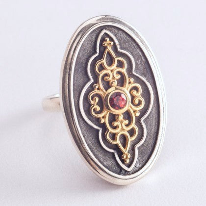 Gorgeous, oval signet ring with garnet and gold plated detailing  Ring Sterling silver handcrafted jewellery. 925 pure silver jewellery. Earrings, nose pins, rings, necklaces, cufflinks, pendants, jhumkas, gold plated, bidri, gemstone jewellery. Handmade in India, fair trade, artisan jewellery.
