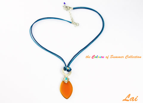 Artistic, navette shape amber colour glass pendant on contrasting blue cord  Necklace, Pendant Sterling silver handcrafted jewellery. 925 pure silver jewellery. Earrings, nose pins, rings, necklaces, cufflinks, pendants, jhumkas, gold plated, bidri, gemstone jewellery. Handmade in India, fair trade, artisan jewellery.