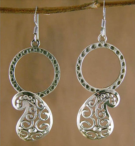 Unique dangling paisley from a hammered circle earrings (PB-1436-ER)  Earrings Sterling silver handcrafted jewellery. 925 pure silver jewellery. Earrings, nose pins, rings, necklaces, cufflinks, pendants, jhumkas, gold plated, bidri, gemstone jewellery. Handmade in India, fair trade, artisan jewellery.