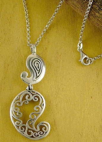 Playful, stunning, double paisley pendant with fine cutout detailing