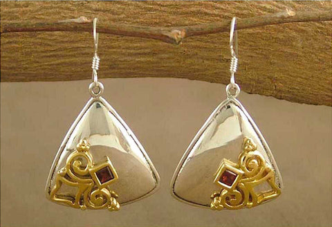 Elegant, triangular dangle earrings with garnet and gold plated detailing