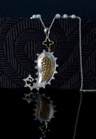 Exquisite, paisley jali pendant with pearls accented chain
