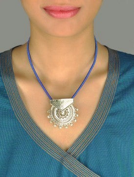 Exquisite, Kutch-inspired, round sunburst jali pendant with hammer finish  Necklace, Pendant Sterling silver handcrafted jewellery. 925 pure silver jewellery. Earrings, nose pins, rings, necklaces, cufflinks, pendants, jhumkas, gold plated, bidri, gemstone jewellery. Handmade in India, fair trade, artisan jewellery.