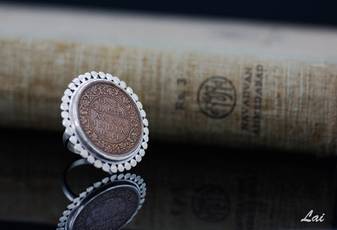 Dramatic, vintage Indian-coin ring with a silver border