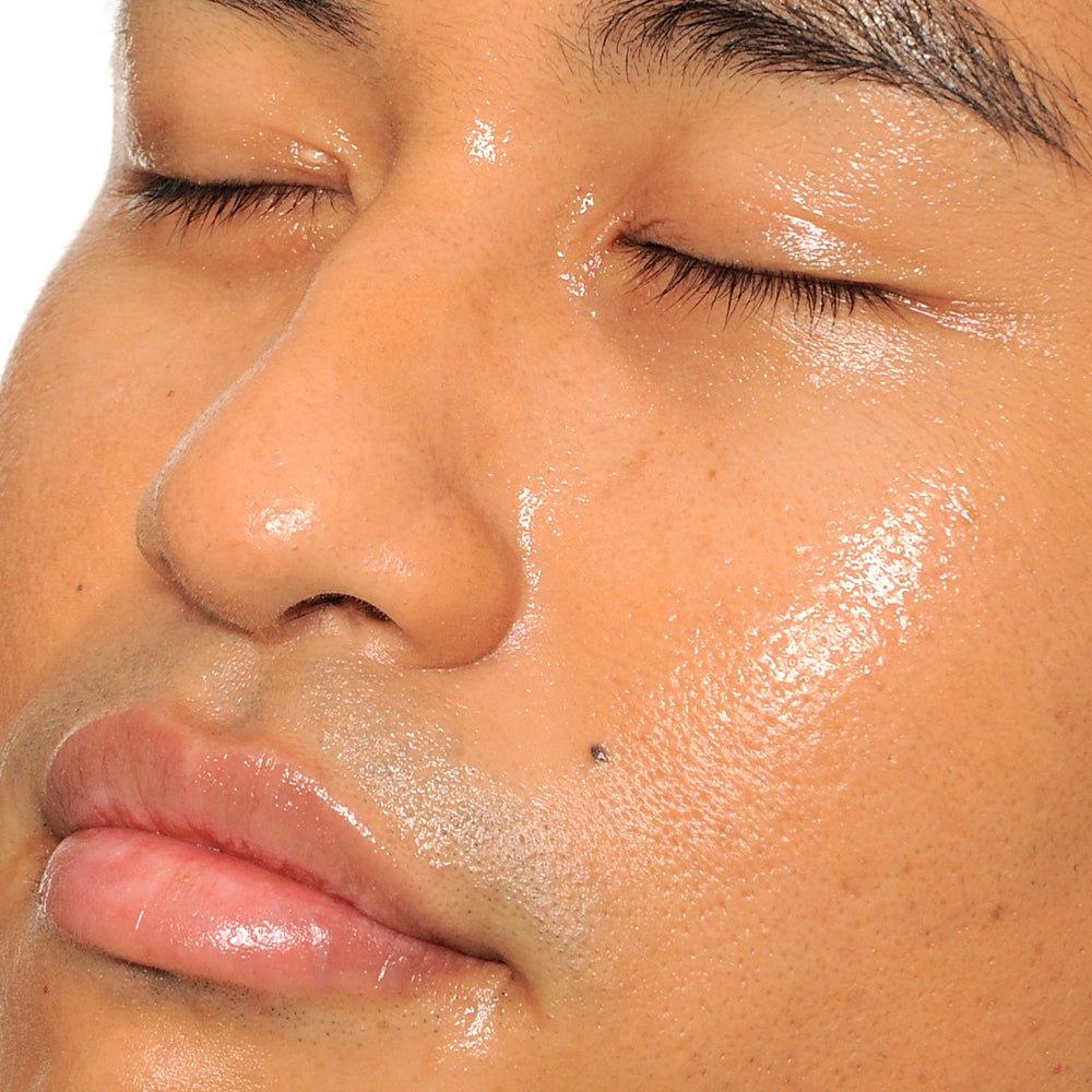 closeup of man's face with glowy skin
