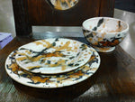 Dinnerware shown in Cowboy  Dine on Fine Art!
