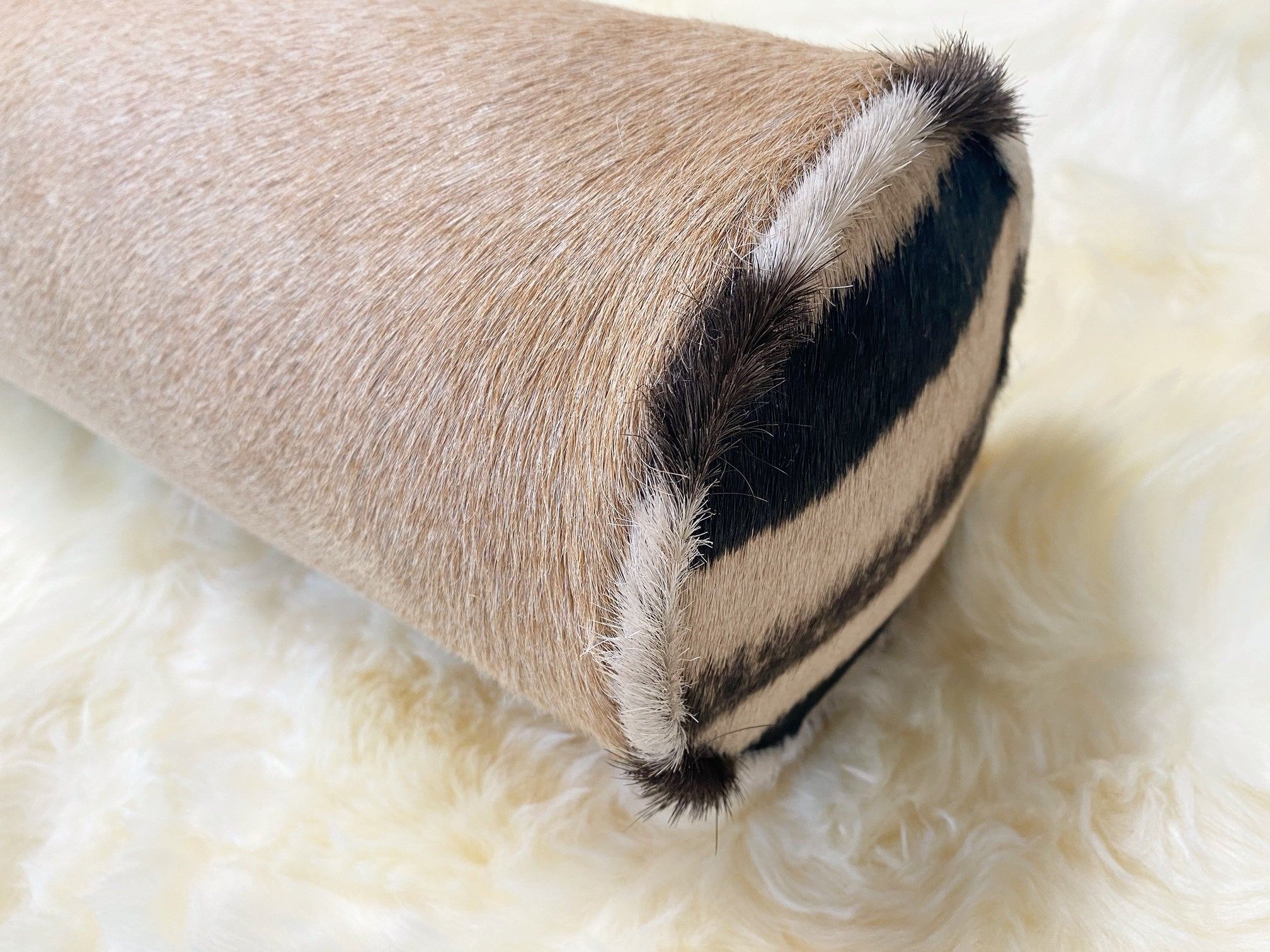 Palomino Cowhide and Zebra Hide Bolster Pillow, 20""
