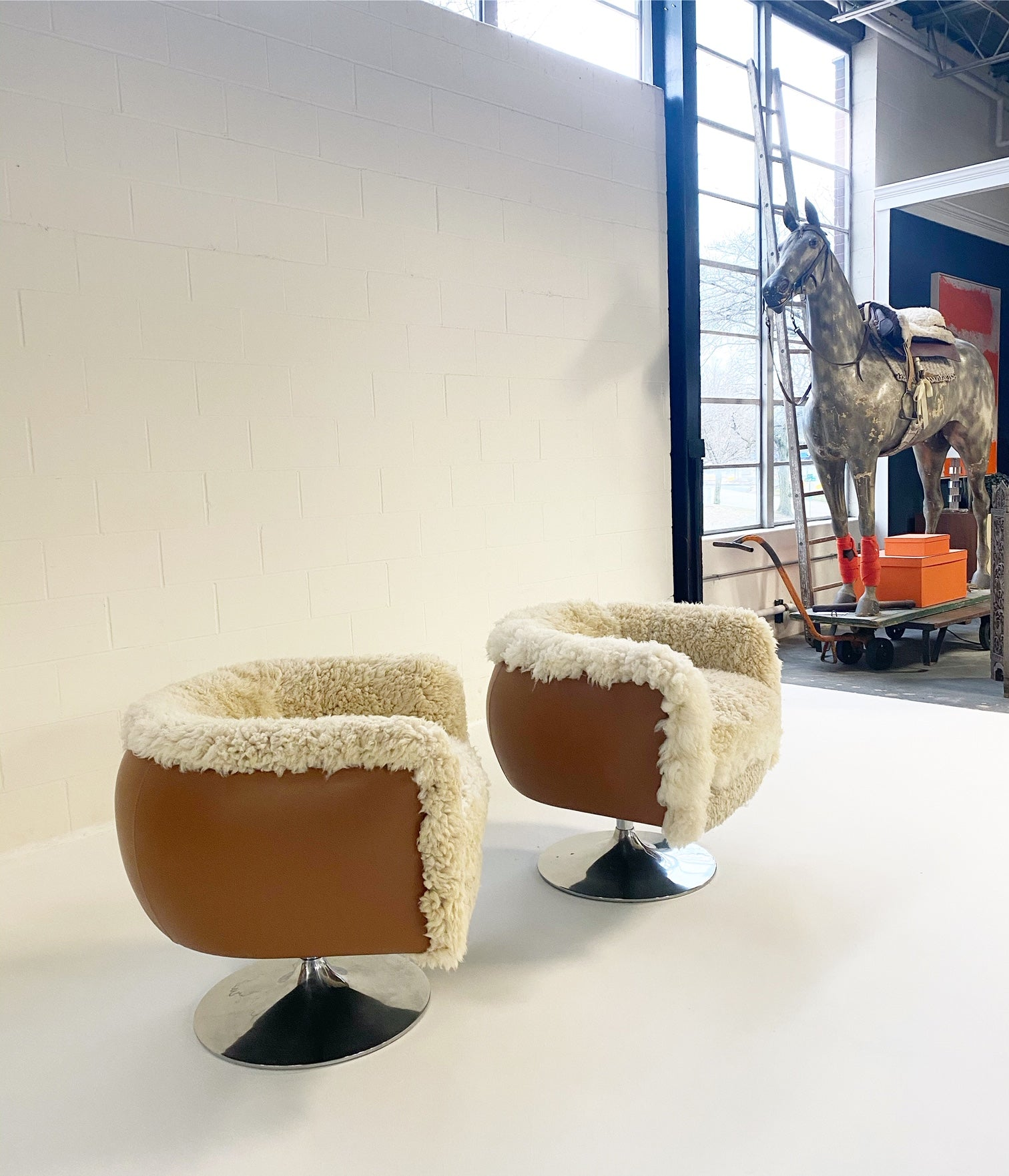 Swivel Lounge Chairs in California Sheepskin and Loro Piana Leather, pair - FORSYTH