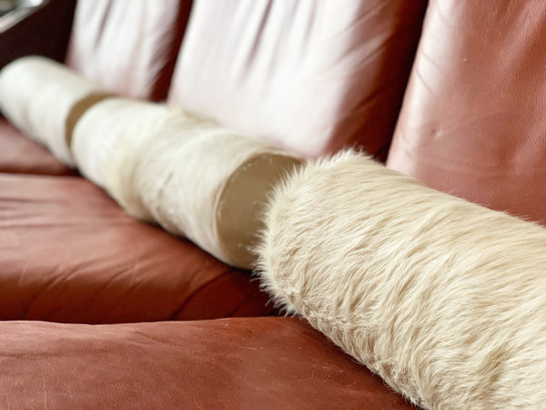 "Ivory Cowhide Bolster Pillow, 20"" - FORSYTH"