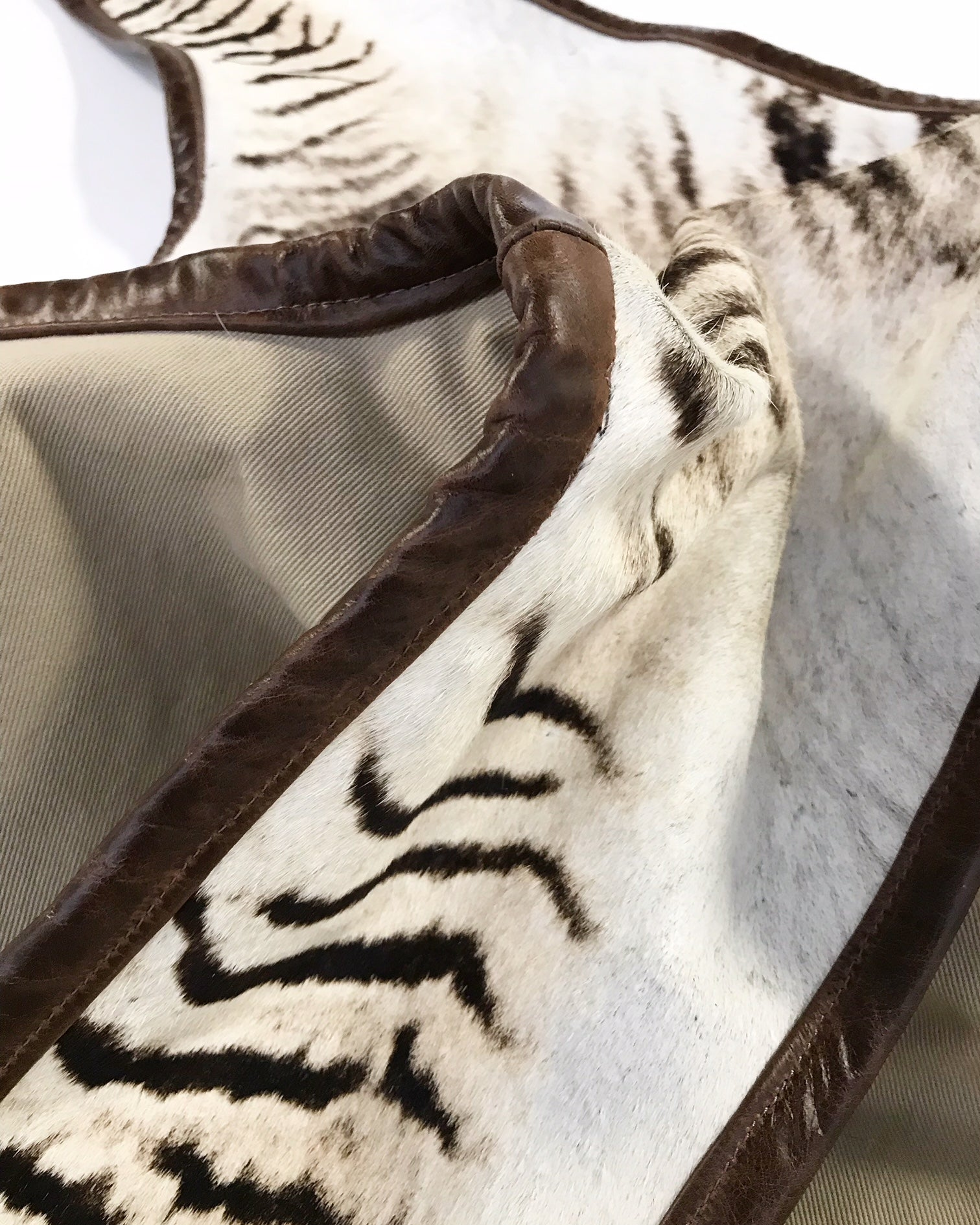 Zebra Hide Rug, Trimmed in Leather - FORSYTH