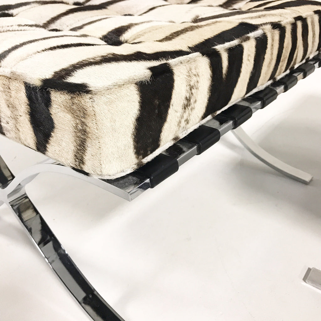 Pair of Barcelona Style Ottomans Restored in Patchwork Zebra Hide - FORSYTH
