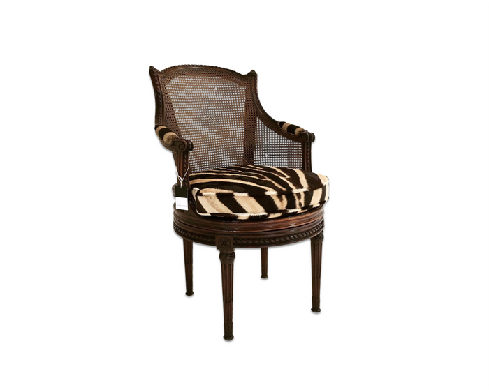Antique Bergere Swivel Chair in Zebra Hide - FORSYTH