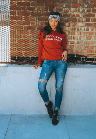 Amber Sosa wearing Vegetaryn Good Food Good Mood sweatshirt