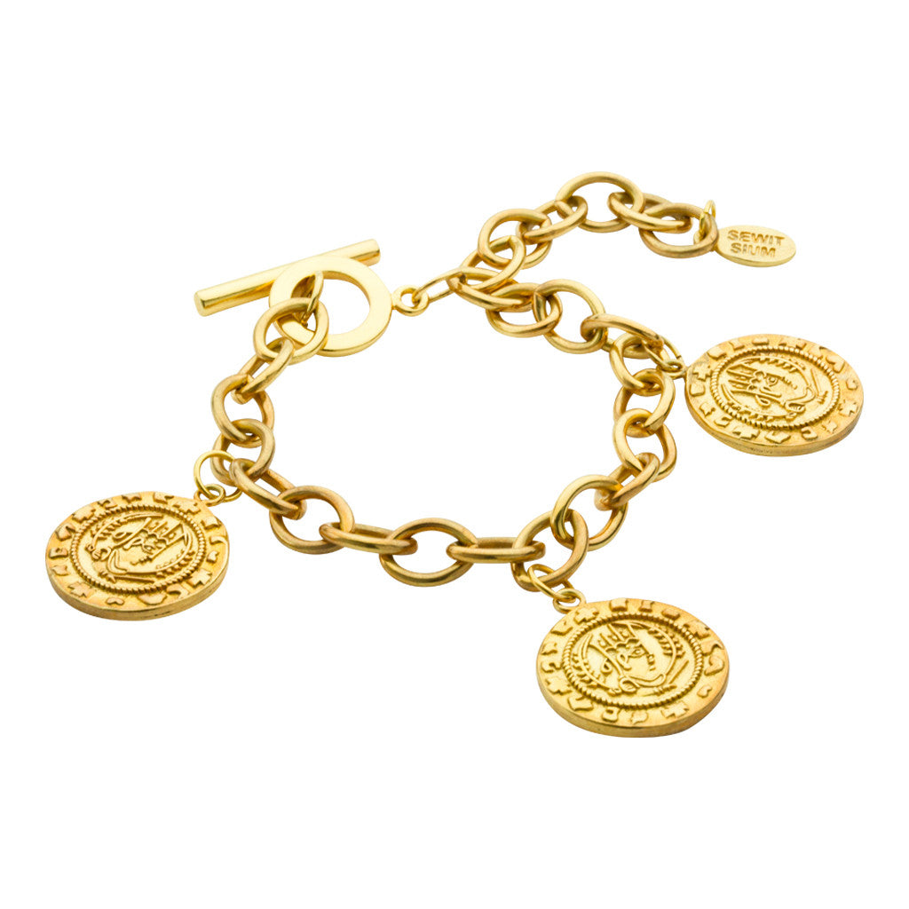 Axum charm bracelet, Classic coin charm bracelet inspired by ancient Axum civilisation in burnish gold. Finished with toggle closure