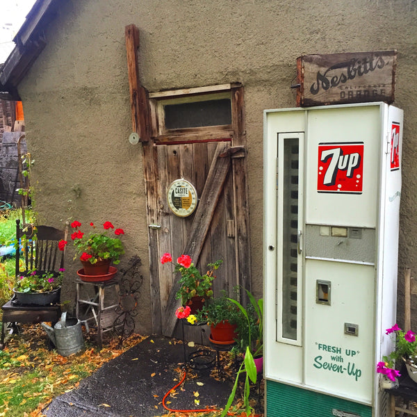 Vintage 7up vending machine sits outside an old farmhouse in Livingstone, Montana