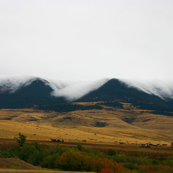 Livingston, Montana as clouds roll over the mountains on the road to yellowstone national Park