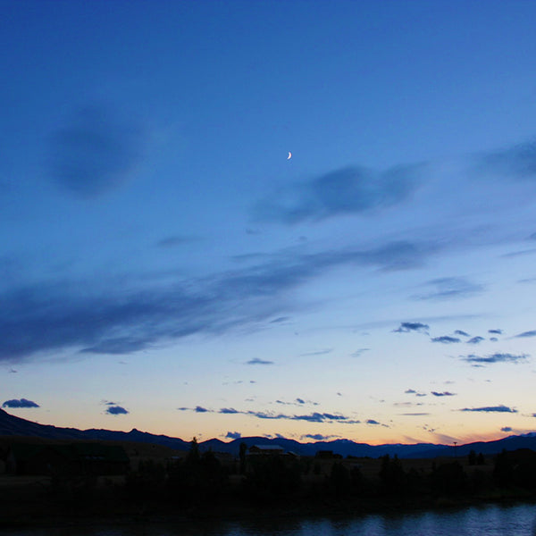 A crescent moon above Beartooth Mountain Range in Montana