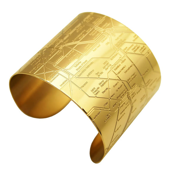 Designhype's 18k gold plated Paris Metro Cuff map bracelet with lines detailing the infamous Parisian subway for women who love wanderlust jewelry and all things Paris.