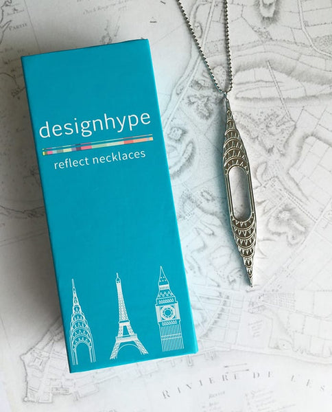 Designhype's stainless steel, art deco inspired, Chrysler Building Necklace and gift box for women who have NYC wanderlust