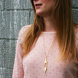 Designhype's 18K gold plated, art deco inspired, Chrysler Building Necklace for women who have NYC wanderlust