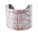 Designhype's London Tube Cuff subway map bracelet with red embossed lines detailing the London Underground. A unique, funky bracelet made for wanderlust travelers.