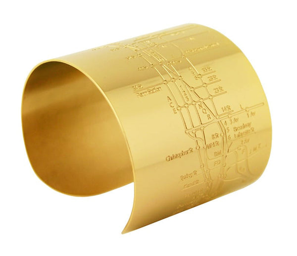 Designhype's design inspired 18k gold plated NYC Metro Cuff Subway Map bracelet with embossed lines of the MTA subway. The perfect gift for women who love the Big Apple