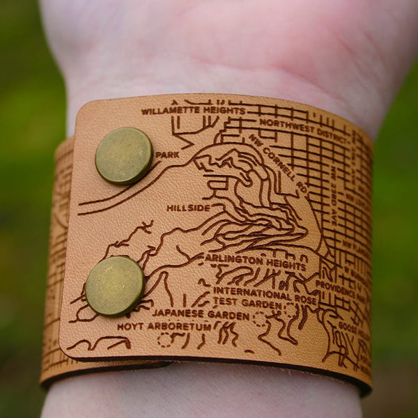 Designhype's Portland City Cuff Bracelet with Portland's famous bridges, streets and landmarks detailed in engraved leather.