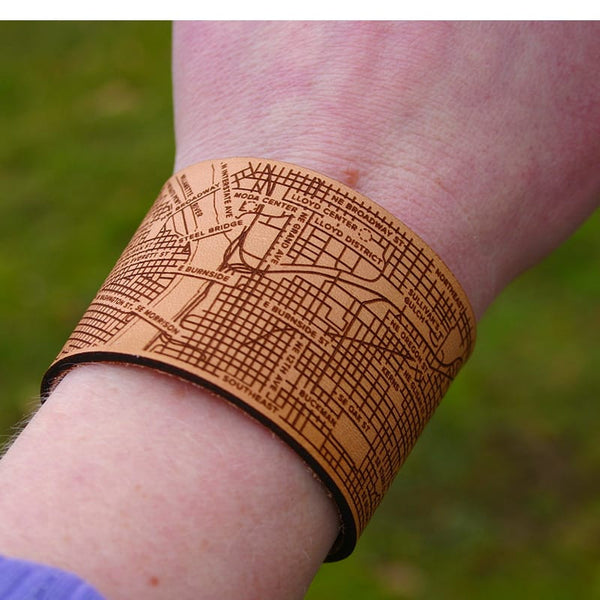 Designhype's Portland City Cuff Bracelet engraved on leather with details of the bridges, streets and landmarks.