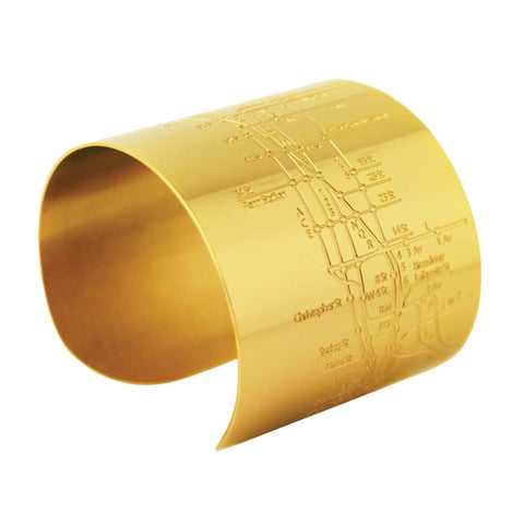 Designhype's 18k gold plated NYC Metro Cuff Subway Map bracelet with embossed lines of the MTA subway. The perfect gift for women who love the Big Apple