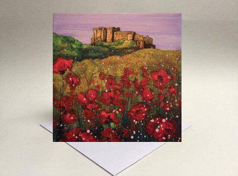 Greetings card Evening poppies at Bamburgh Castle Northumberland