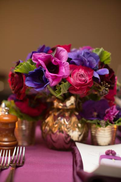 bright pink, purple flowers in gold vases Anissa Rae Flowers