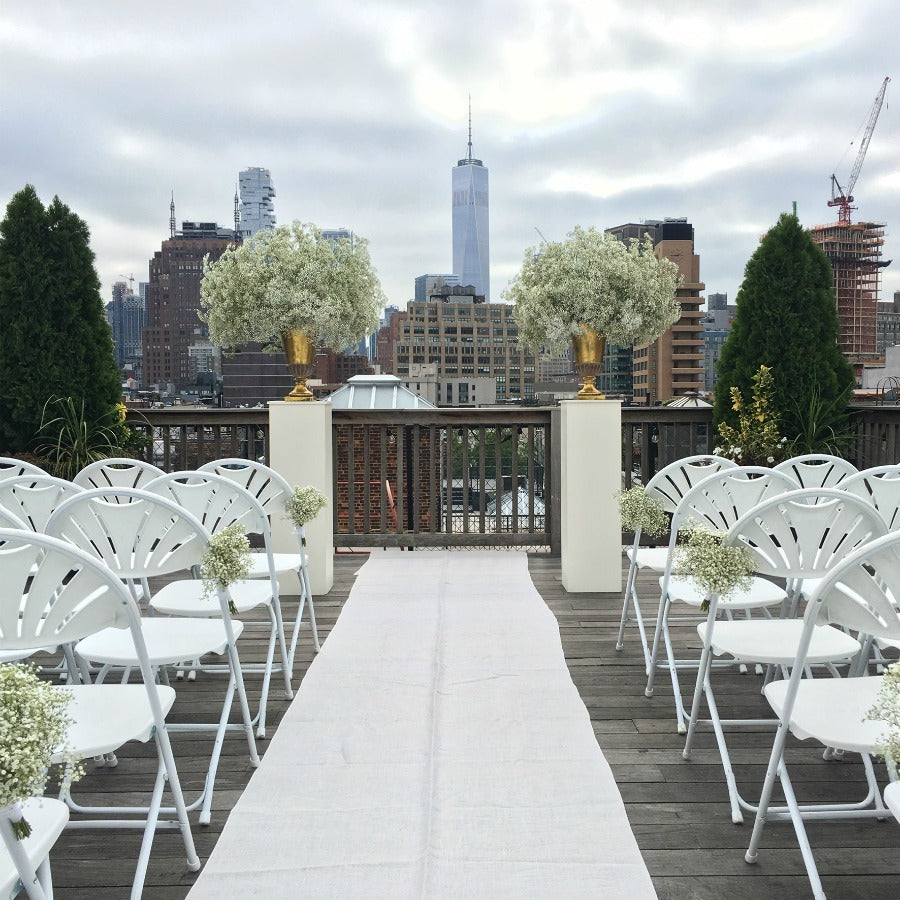 Romantic and ethereal baby's breath wedding ceremony on NYC Rooftop by Anissa Rae Flowers